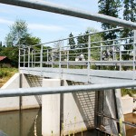 Construction and installation of a steel footbridge and of a steel security gate